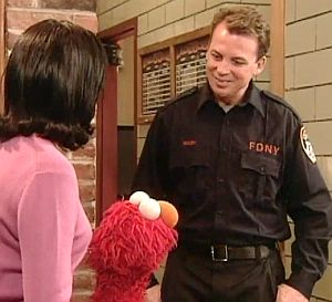 Bill Walsh (firefighter) Bil Walsh shows Maria and Elmo