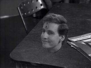 Arnold in a desk