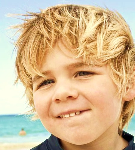 Image Blonde Boy With Windswept Hair On Beach 241900001