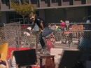 1x2 Dennis climbs fence.png