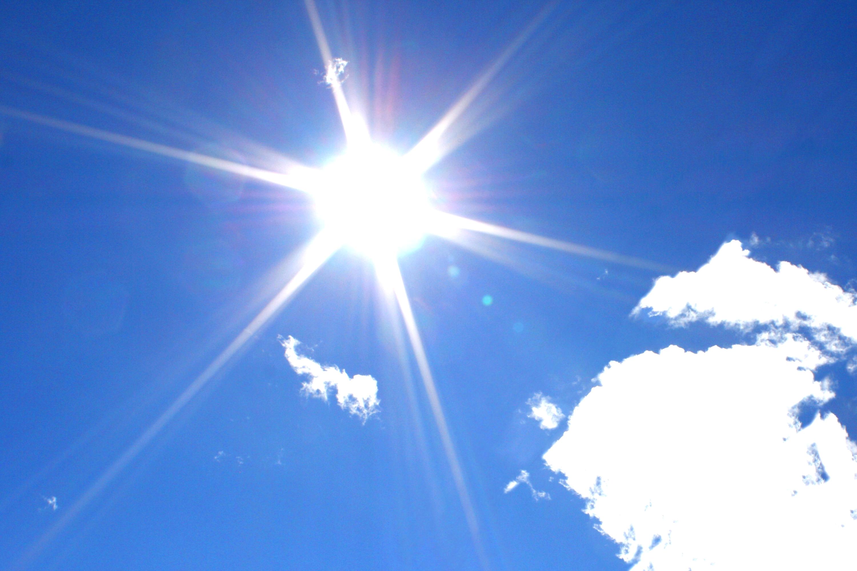 white sun in blue sky