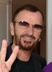 220px-Ringo Starr and a fan backstage in Hamburg, July 2011a