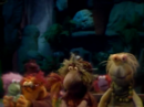 Rainshower Fraggle with vest and neckless.png