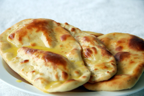 a history of naan Naan or nan is a leavened, clay oven-baked flatbread popular in the cuisines   the flour used in an authentic indian naan bread recipe may be atta  196  flavors is a unique world cuisine and food history blog created and.