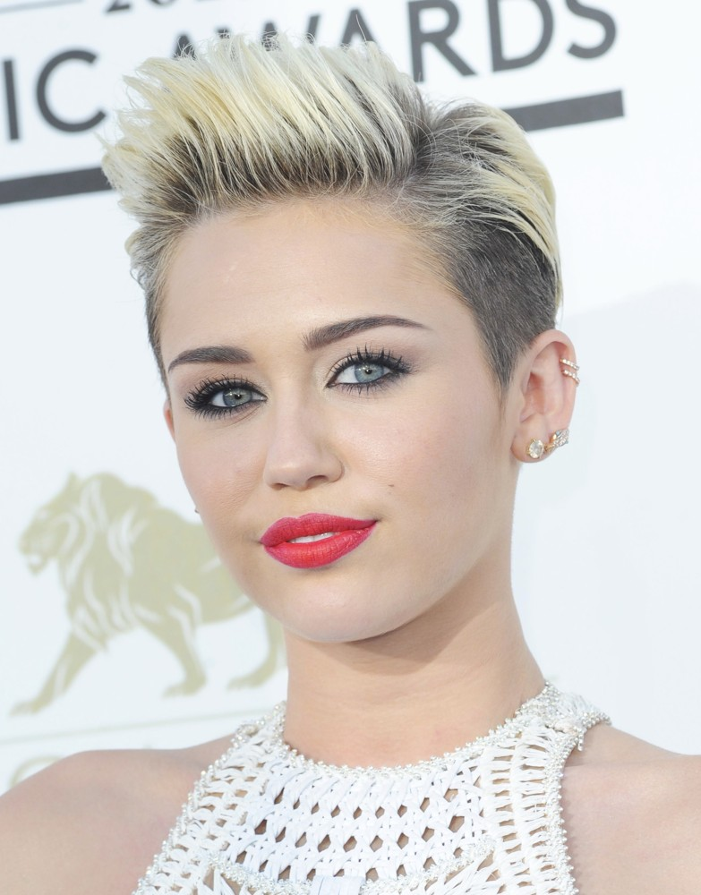 overview of miley cyrus image 5 days ago  miley is the daughter of country legend billy ray and first hit the big time when  she landed the lead in disney's hannah montana thanks to the.