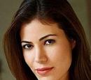 Adela Corinthos (Iris Almario)