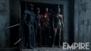 Batman, Flash, Cyborg and Wonder Woman stand in a doorway.png